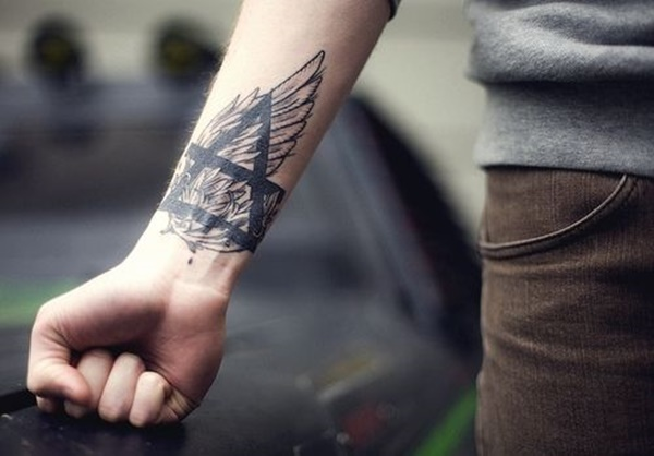 Forearm Tattoo Ideas and Designs 71-Wing Tattoo + Earth symbol
